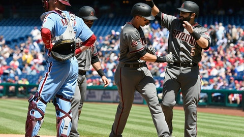 Arizona Diamondbacks' Nick Ahmed, second from right, is congratulated by Alex Avila, right, after Ahmed hit a three-run home run off Philadelphia Phillies' Ben Lively during the third inning of a baseball game, Thursday, April 26, 2018, in Philadelphia. (AP Photo/Derik Hamilton)