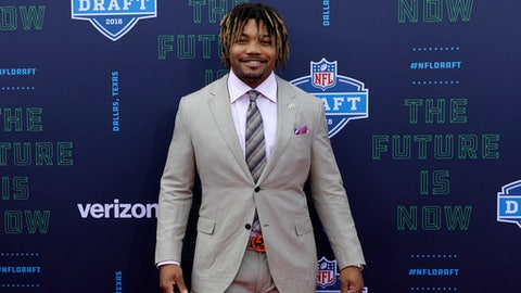 LSU's Derrius Guice poses for photos on the red carpet during the first round of the NFL football draft, Thursday, April 26, 2018, in Arlington, Texas. (AP Photo/Eric Gay)