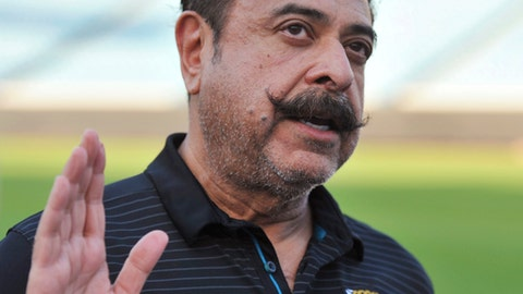 Jacksonville Jaguars owner Shad Khan fields questions from the media on his interest in buying Wembley Stadium in London, Thursday, April 26, 2018, in Jacksonville, Fla. The English Football Association has received an offer from Khan of about 600 million pounds ($840 million) for the national soccer stadium, which would continue to host England games and major cup finals after a sale. Wembley has staged regular-season NFL games since 2007 and Khan's Florida-based franchise started playing at the 90,000-capacity stadium in 2013, the year Khan bought London soccer club Fulham. (Bob SelfThe Florida Times-Union via AP)