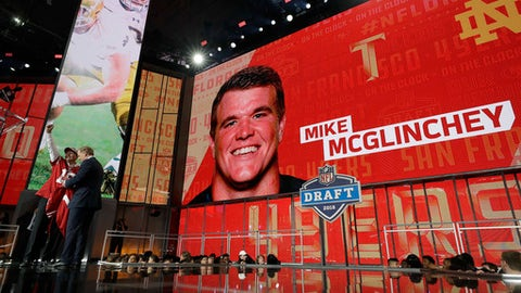 A fan poses with a team jersey and Commissioner Roger Goodell after Notre Dame's Mike McGlinchey was selected by the San Francisco 49ers during the first round of the NFL football draft, Thursday, April 26, 2018, in Arlington, Texas. (AP Photo/David J. Phillip)