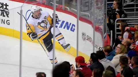 Pittsburgh Penguins center Sidney Crosby (87) celebrates his goal during the third period in Game 1 of an NHL second-round hockey playoff series against the Washington Capitals, Thursday, April 26, 2018, in Washington. The Penguins won 3-2. (AP Photo/Nick Wass)
