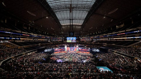 In this general overall view of AT&T Stadium, Georgia's Roquan Smith is shown on the video screen after being selected by the Chicago Bears during the first round of the NFL football draft, Thursday, April 26, 2018, in Arlington, Texas. (AP Photo/David J. Phillip)