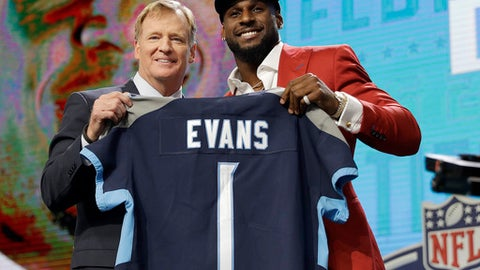 Commissioner Roger Goodell, left, presents Alabama's Rashaan Evans with his Tennessee Titans jersey during the first round of the NFL football draft, Thursday, April 26, 2018, in Arlington, Texas. (AP Photo/David J. Phillip)