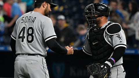 Chicago White Sox closer Joakim Soria (48) and catcher Welington Castillo celebrate the team's 6-3 win over the Kansas City Royals in a baseball game Thursday, April 26, 2018, in Kansas City, Mo. (AP Photo/Ed Zurga)