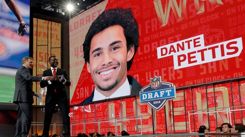 NFL Commissioner Roger Goodell, left, and former player Merton Hanks walk off the stage after announcing Washington's Dante Pettis as the San Francisco 49ers' pick during the second round of the NFL football draft Friday, April 27, 2018, in Arlington, Texas. (AP Photo/Eric Gay)