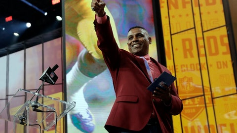 Former Washington Redskins player Gary Clark walks away from the podium after announcing LSU's Derrius Guice as the team's pick during the second round of the NFL football draft Friday, April 27, 2018, in Arlington, Texas. (AP Photo/Eric Gay)