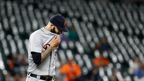 Detroit Tigers starting pitcher Mike Fiers pauses after Baltimore Orioles second baseman Jace Peterson stole third base during the sixth inning of a baseball game Friday, April 27, 2018, in Baltimore. (AP Photo/Patrick Semansky)