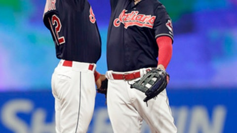 Cleveland Indians' Francisco Lindor, left, and Tyler Naquin celebrate after the Indians defeated the Seattle Mariners 6-5 in a baseball game Friday, April 27, 2018, in Cleveland. (AP Photo/Tony Dejak)