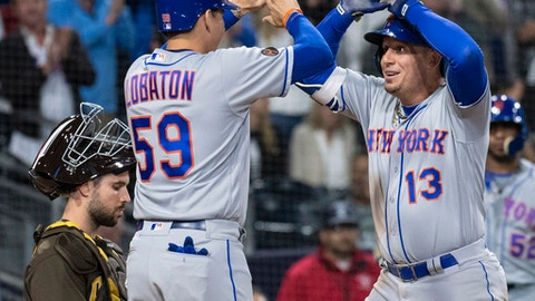 New York Mets' Asdrubal Cabrera, right, celebrates his three-run home run with Jose Lobaton as San Diego Padres catcher Austin Hedges waits during the seventh inning of a baseball game in San Diego, Friday, April, 27, 2018. (AP Photo/Kyusung Gong)