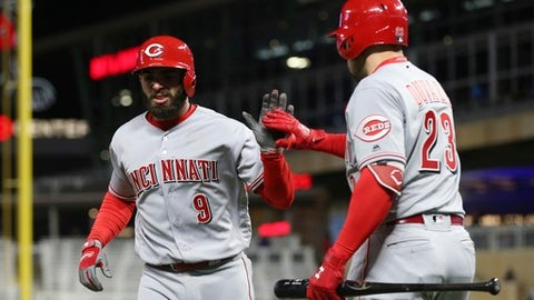 Cincinnati Reds' Jose Peraza, left, is congratulated by Adam Duvall after his solo home run off Minnesota Twins pitcher David Hale during the ninth inning of a baseball game Friday, April 27, 2018, in Minneapolis. The Reds won 15-9. (AP Photo/Jim Mone)
