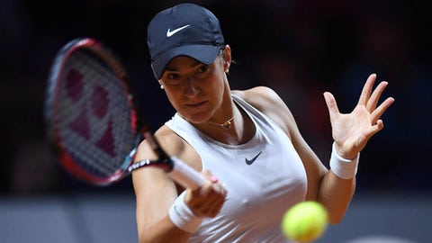 Caroline Garcia returns a shot to Coco Vandeweghe from the U.S. during their semifinal match of the WTA tennis tournament in Stuttgart, Germany, Saturday, April 28, 2018. (Marijan Murat/dpa via AP)