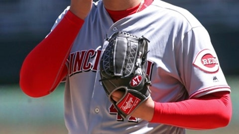 Cincinnati Reds' pitcher Sal Romano wipes his face after giving up a walk to Minnesota Twins' Ehire Adrianza in the third inning of a baseball game Saturday, April 28, 2018, in Minneapolis. (AP Photo/Jim Mone)