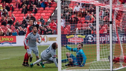 Chicago Fire forward Nemanja Nikolic (23) watches as his shot hit the crossbar while Toronto FC goalkeeper Alex Bono looks on during second-half MLS soccer game action in Toronto, Saturday, April 28, 2018. (Chris Young/The Canadian Press via AP)