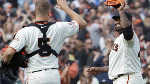 San Francisco Giants' Pablo Sandoval, right, high-fives catcher Nick Hundley (5) after pitching against the Los Angeles Dodgers during the ninth inning of a baseball game in San Francisco, Saturday, April 28, 2018. The Dodgers won 15-6. (AP Photo/Jeff Chiu)