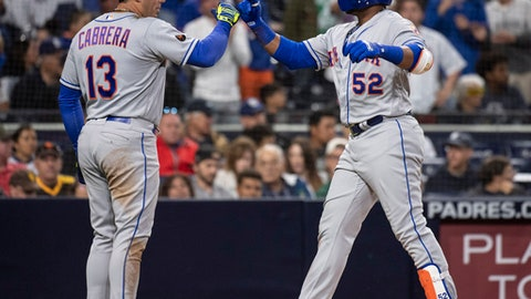 New York Mets' Yoenis Cespedes, right, celebrates his two-run home run with Asdrubal Cabrera during the sixth inning of a baseball game against the San Diego Padres in San Diego, Saturday, April 28, 2018. (AP Photo/Kyusung Gong)