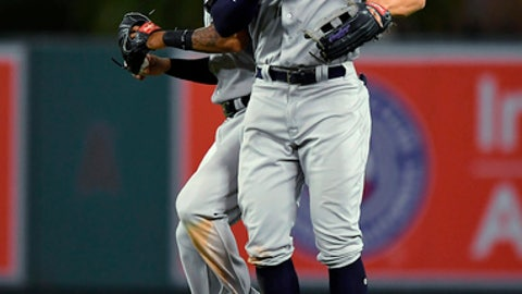 New York Yankees center fielder Aaron Hicks, left, and right fielder Aaron Judge celebrate after the Yankees defeated the Los Angeles Angels 11-1 in a baseball game Saturday, April 28, 2018, in Anaheim, Calif. (AP Photo/Mark J. Terrill)