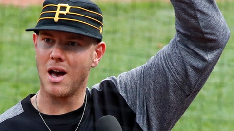 Pittsburgh Pirates starting pitcher Nick Kingham thanks fans after getting his first major league win, over the St. Louis Cardinals, in a baseball game in Pittsburgh, Sunday, April 29, 2018. (AP Photo/Gene J. Puskar)