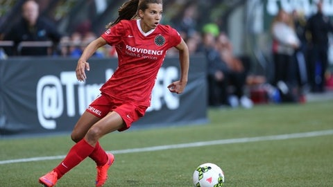 FILE - In this April 11, 2015, file photo, Portland Thorns FC midfielder Tobin Heath (17) turns the ball back toward the goal in the first half against the Boston Breakers in the Thorns' season-opening NWSL match at Providence Park in Portland, Ore. Heath, a U.S. national team veteran who is considered among the best players in the world, has returned to her NWSL club after spending the better part of the past year dealing with all-too-human injuries.  (AP Photo/The Oregonian, Randy L. Rasmussen, File)