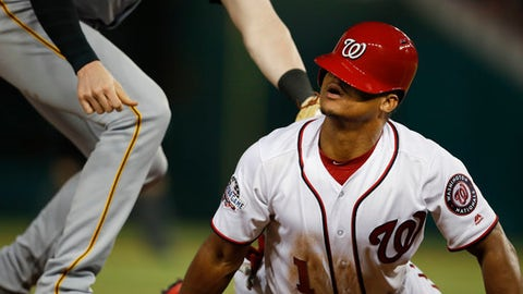 Washington Nationals' Wilmer Difo looks up after sliding back into third after a failed pick-off attempt by Pittsburgh Pirates third baseman Colin Moran (19), during the fourth inning of a baseball game at Nationals Park, Monday, April 30, 2018, in Washington. (AP Photo/Pablo Martinez Monsivais)
