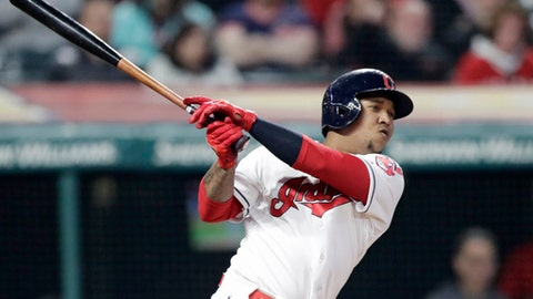 Cleveland Indians' Jose Ramirez hits a one-run double in the eighth inning of a baseball game against the Texas Rangers, Monday, April 30, 2018, in Cleveland. Bradley Zimmer scored on the play. (AP Photo/Tony Dejak)