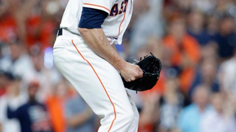 Houston Astros' relief pitcher Ken Giles (53) reacts after striking out New York Yankees' center fielder Aaron Hicks (31) to end a baseball game Monday, April 30, 2018, in Houston. The Astros defeated the Yankees 2-1. (AP Photo/Michael Wyke)