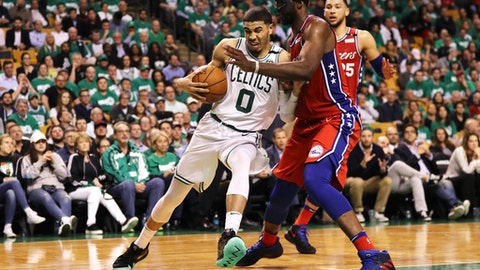 BOSTON, MA - APRIL 30: Joel Embiid #21 of the Philadelphia 76ers defends Jayson Tatum #0 of the Boston Celtics during the second half of Game One in Round Two of the 2018 NBA Playoffs at TD Garden on April 30, 2018 in Boston, Massachusetts. The Celtics defeat the 76ers 117-101. (Photo by Maddie Meyer/Getty Images)