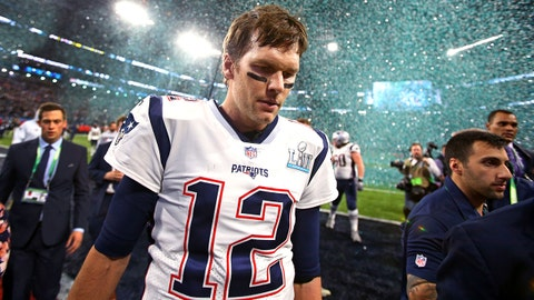 Feb 4, 2018; Minneapolis, MN, USA; Confetti falls as New England Patriots quarterback Tom Brady (12) walks off the field after Super Bowl LII against the Philadelphia Eagles at U.S. Bank Stadium. Mandatory Credit: Mark J. Rebilas-USA TODAY Sports