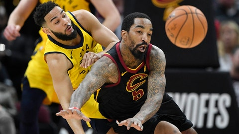 Apr 15, 2018; Cleveland, OH, USA; Indiana Pacers guard Cory Joseph (6) and Cleveland Cavaliers guard JR Smith (5) play for the ball in the second quarter in game one of the first round of the 2018 NBA Playoffs at Quicken Loans Arena. Mandatory Credit: David Richard-USA TODAY Sports