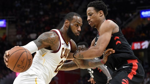 Apr 3, 2018; Cleveland, OH, USA; Cleveland Cavaliers forward LeBron James (23) drives against Toronto Raptors guard DeMar DeRozan (10) in the fourth quarter at Quicken Loans Arena. Mandatory Credit: David Richard-USA TODAY Sports