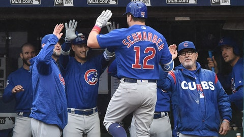 Apr 24, 2018; Cleveland, OH, USA; Chicago Cubs designated hitter Kyle Schwarber (12) celebrates in the dugout after hitting his second home run of the game during the fourth inning against the Cleveland Indians at Progressive Field. Mandatory Credit: Ken Blaze-USA TODAY Sports