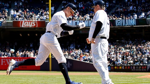 Apr 21, 2018; Bronx, NY, USA; New York Yankees right fielder Aaron Judge (99) celebrates a two-run home run with Yankees third base coach Phil Nevin (53) against the Toronto Blue Jays during the third inning at Yankee Stadium. Mandatory Credit: Adam Hunger-USA TODAY Sports