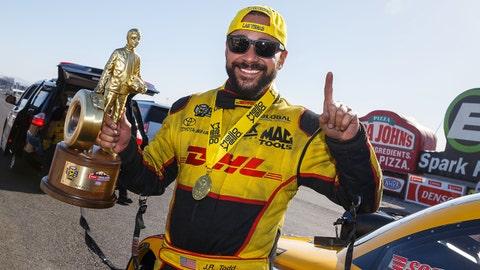 Apr 8, 2018; Las Vegas, NV, USA; NHRA funny car driver J.R. Todd celebrates after winning the Four Wide Nationals at The Strip at Las Vegas Motor Speedway. Mandatory Credit: Mark J. Rebilas-USA TODAY Sports