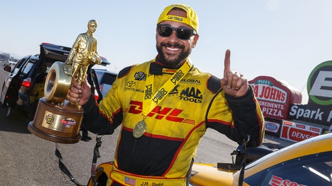 Apr 8, 2018; Las Vegas, NV, USA; NHRA funny car driver J.R. Todd celebrates after winning the Four Wide Nationals at The Strip at Las Vegas Motor Speedway. Mandatory Credit: Mark J. Rebilas-USA TODAY Sports