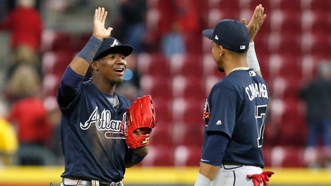 Apr 25, 2018; Cincinnati, OH, USA; Atlanta Braves center fielder Ronald Acuna Jr. (left) react with Atlanta Braves shortstop Dansby Swanson (right) after the Braves defeated the Cincinnati Reds at Great American Ball Park. Mandatory Credit: David Kohl-USA TODAY Sports