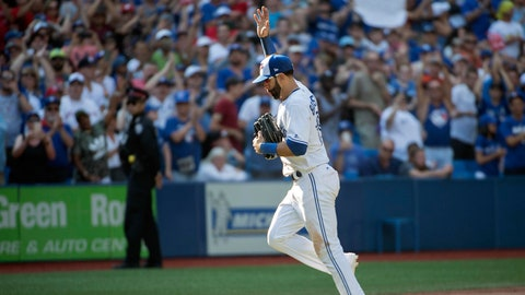 Sep 24, 2017; Toronto, Ontario, CAN; Toronto Blue Jays right fielder Jose Bautista (19) acknowledges the crowd as he runs towards the dugout in the ninth inning during a game against the New York Yankees at Rogers Centre. Mandatory Credit: Nick Turchiaro-USA TODAY Sports