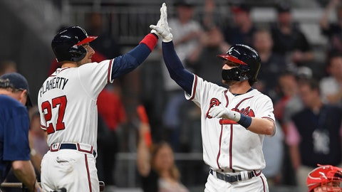 Apr 18, 2018; Atlanta, GA, USA; Atlanta Braves shortstop Dansby Swanson (7) gets a high five from Ryan Flaherty (27) after hitting a home run against the Philadelphia Phillies during the seventh inning at SunTrust Park. Mandatory Credit: Dale Zanine-USA TODAY Sports
