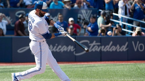 Sep 24, 2017; Toronto, Ontario, CAN; Toronto Blue Jays right fielder Jose Bautista (19) hits a single in the first inning during a game against the New York Yankees at Rogers Centre. Mandatory Credit: Nick Turchiaro-USA TODAY Sports