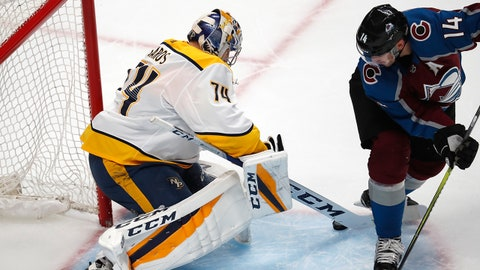 Nashville Predators goaltender Juuse Saros, left, makes a stick save of a shot by Colorado Avalanche left wing Blake Comeau in the third period of Game 3 of an NHL hockey first-round playoff series, Monday, April 16, 2018, in Denver. Colorado won 5-3. (AP Photo/David Zalubowski)