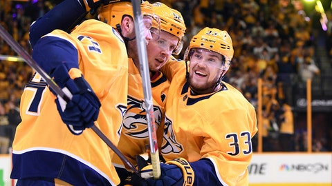 Apr 14, 2018; Nashville, TN, USA; Nashville Predators defenseman Mattias Ekholm (14) and left wing Viktor Arvidsson (33) congratulate center Ryan Johansen (92) after a goal during the second period against the Colorado Avalanche in game two of the first round of the 2018 Stanley Cup Playoffs at Bridgestone Arena. Mandatory Credit: Christopher Hanewinckel-USA TODAY Sports