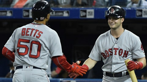 Apr 25, 2018; Toronto, Ontario, CAN;   Boston Red Sox right fielder Mookie Betts (50) is greeted by left fielder Andrew Benintendi (16) after hitting a home run against Toronto Blue Jays in the first inning at Rogers Centre. Mandatory Credit: Dan Hamilton-USA TODAY Sports