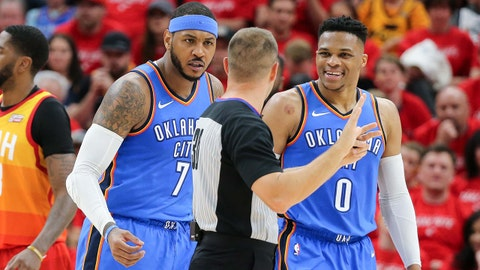 Apr 21, 2018; Salt Lake City, UT, USA; Oklahoma City Thunder forward Carmelo Anthony (7) and guard Russell Westbrook (0) complain to referee John Goble (30) after Anthony is called for a foul during the second quarter against the Utah Jazz in game three of the first round of the 2018 NBA Playoffs at Vivint Smart Home Arena. Mandatory Credit: Chris Nicoll-USA TODAY Sports