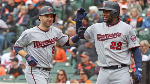 Apr 1, 2018; Baltimore, MD, USA; Minnesota Twins second baseman Brian Dozier (2) is greeted by third baseman Miguel Sano (22) following his lead off home run against the Baltimore Orioles at Oriole Park at Camden Yards. Mandatory Credit: Mitch Stringer-USA TODAY Sports
