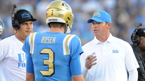 September 10, 2016; Pasadena, CA, USA;  UCLA Bruins quarterback Josh Rosen (3) speaks with head coach Jim Mora and offensive coordinator Kennedy Polamalu after a touchdown scored against the UNLV Rebels during the first half at Rose Bowl. Mandatory Credit: Gary A. Vasquez-USA TODAY Sports