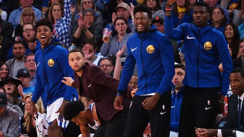 Mar 16, 2018; Oakland, CA, USA; Golden State Warriors guard Stephen Curry (30) and bench react to a play against the Sacramento Kings during the first quarter at Oracle Arena. Mandatory Credit: Kelley L Cox-USA TODAY Sports