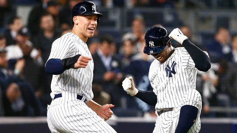 Apr 24, 2018; Bronx, NY, USA;  New York Yankees right fielder Aaron Judge (99) and New York Yankees shortstop Didi Gregorius (18) celebrate after scoring in the fifth inning against the Minnesota Twins at Yankee Stadium. Mandatory Credit: Noah K. Murray-USA TODAY Sports