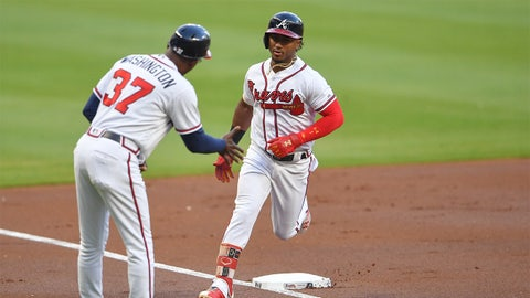 Apr 20, 2018; Atlanta, GA, USA; Atlanta Braves second baseman Ozzie Albies (1) reacts with third base coach Ron Washington (37) after hitting a home run against the New York Mets during the first inning at SunTrust Park. Mandatory Credit: Dale Zanine-USA TODAY Sports