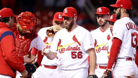 Cardinals lose in 10 in Holland's debut