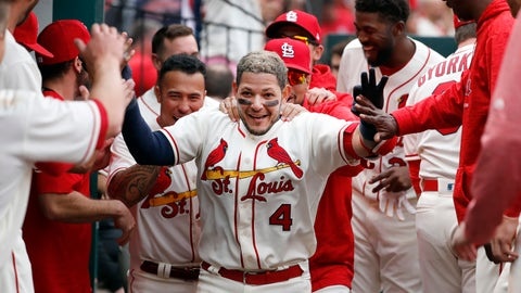 .St. Louis Cardinals' Yadier Molina (4) is congratulated by teammates after hitting a solo home run during the seventh inning of a baseball game against the Cincinnati Reds Saturday, April 21, 2018, in St. Louis. (AP Photo/Jeff Roberson)