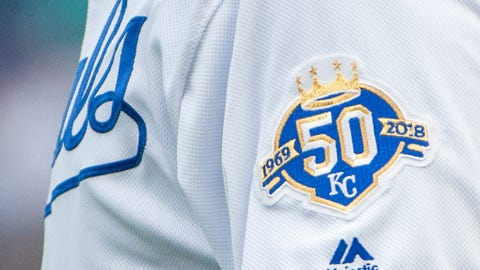 Mar 31, 2018; Kansas City, MO, USA; A 50th Anniversary logo is worn on the shoulder of Kansas City Royals third base coach Mike Jirschele during the game against the Chicago White Sox at Kauffman Stadium. Mandatory Credit: Amy Kontras-USA TODAY Sports