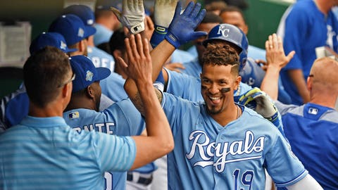 Apr 29, 2018; Kansas City, MO, USA; Kansas City Royals first baseman Cheslor Cuthbert (19) celebrates in the dugout after hitting a three run home run during the fifth inning against the Chicago White Sox at Kauffman Stadium. Mandatory Credit: Peter G. Aiken/USA TODAY Sports